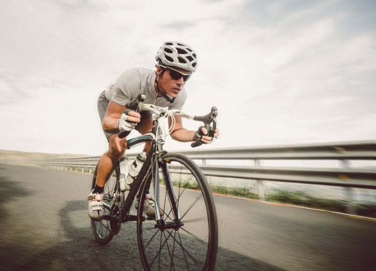 Cyclist pedaling on a racing bike outdoor