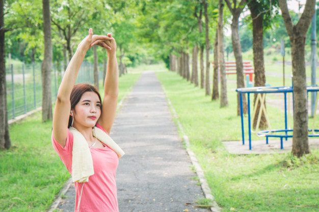 asian girls warm up body before exercise
