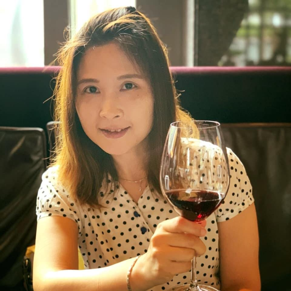 WR Cheng with a wine glass